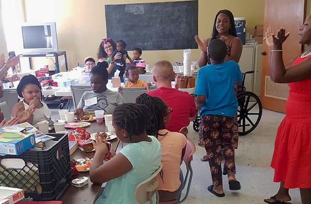 The North Baton Rouge Matters Youth Recreation Group gather at the Wesley United Methodist Church in Baton Rouge, Louisiana, on September 10, 2016, where teachers from Laurel Oaks Charter Academy came out to volunteer their time. (Photo: Crystal Williams)