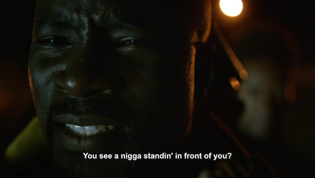 Close up of Mike Colter's face