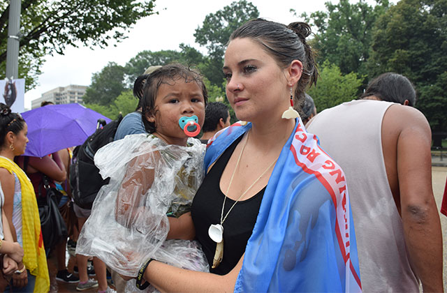 Shailene Woodley and Wiconi American Horse listening to a prayer song at the Washington, D.C., protest.
