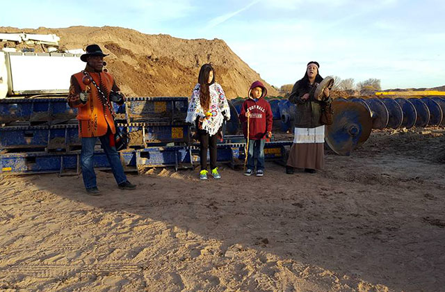 Four unidentified water protectors tap their drums and sing their songs of prayer in solidarity with their fellow water protector who locked herself to construction machinery on January 12, 2017.