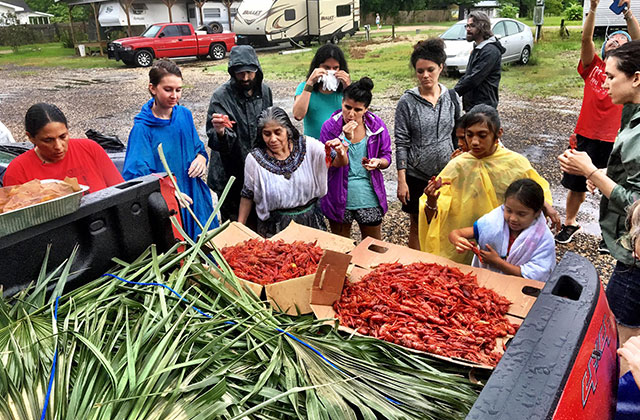 L'eau Est La Vie (Water is Life) Camp members prepare crawfish, a major part of the region's cultural and economic culture, on June 24, 2017, in southern Louisiana.