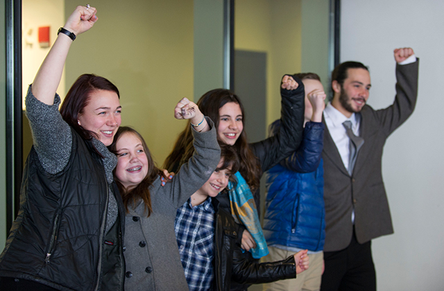 Some of the youth plaintiffs involved in the landmark federal climate lawsuit stand outside the Federal Courthouse in Eugene, Oregon, after a meeting February 7, 2017. The lawsuit, brought by nonprofit legal firm of Our Children's Trust, is moving through