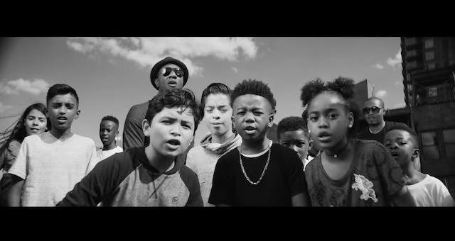 A group of Black and Brown kids perform outside in New York City