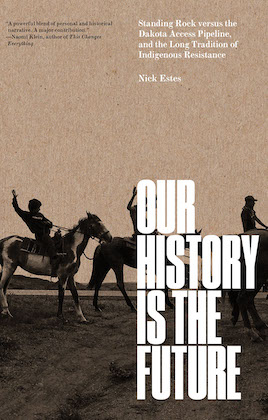 book cover of our history is the future with the book title written in bold all caps font and a light brown background with dark shadows of three Native people riding horses in the foreground