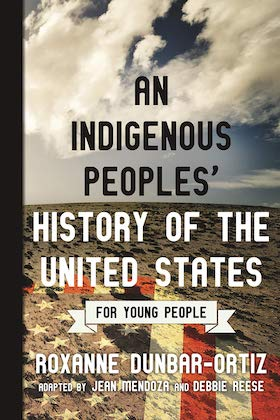 book cover of author roxanne dunbar ortiz's book titled an indigenous people's history of the united spelled in large black and white font against image  of a desert, blue sky and a fading united states of america flag