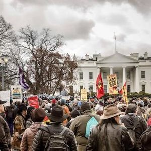 Hundreds of protesters stand in front of the White House for Native Nations Rising march
