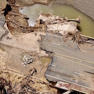 An aerial view of a road in ruins