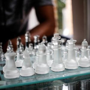 A clear glass chess set