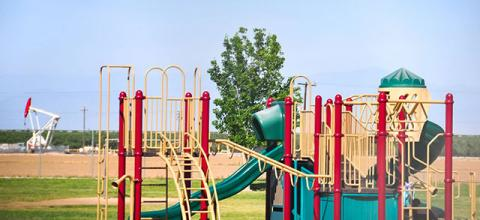 The playground of Sequoia Elementary School in Shafter, California, where Rodrigo Romo's daughers attended, is no more than 400 feet from a fracking well.