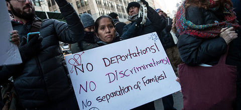 Immigrants and their supporters rally in New York City during a protest against recent Immigration and Customs Enforcement raids on February 16, 2017. Now, a leaked draft memo seeks the National Guard to conduct such raids.