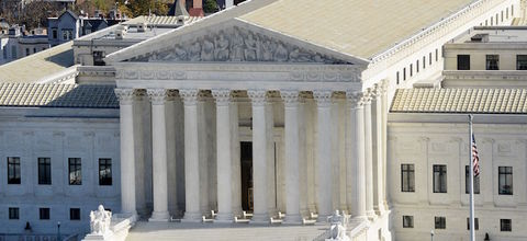 """White building with columns, pointed roof and steps and """"EQUAL JUSTICE UNDER LAW"""" engraved at top"""