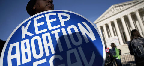 A pro-choice activist  in front of the the U.S. Supreme Court in Washington, DC.