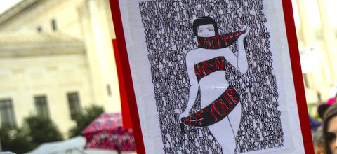 "A drawing of a black and white body wrapped in red ribbon that says ""This is not yours"""