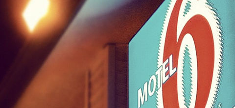 Close-up of Motel 6 discount hotel chain logo.