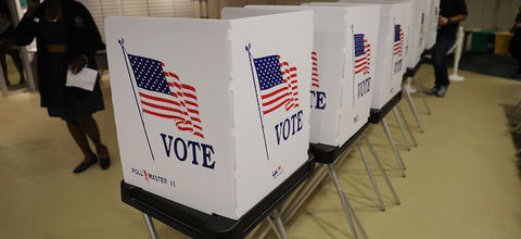 White voting booths adorned by American flags