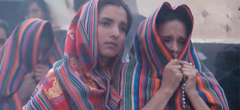 """""""El Norte."""" Central American women, one young, one elder, wrapped in traditional blankets."""