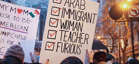 """Protest sign that reads, """"Arab, Immigrant, Woman, Teacher, Furious."""""""