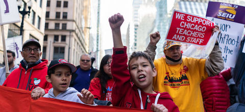 students and others marching in a protest in Chicago