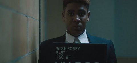 """""""When They See Us."""" Young Black man with flat top getting mug shot taken."""