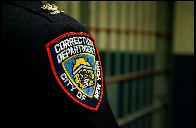 Close up shot of a Correction Department badge on an officer at the Vernon C. Bain Correctional Center at Rikers Island, in the Bronx, New York.
