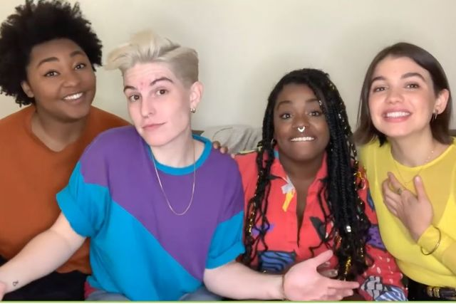Queer the Census. Four people, black woman with afro, white person with short haircut, black woman with locs, Latinx woman with bob smiling, sitttng on a couch together