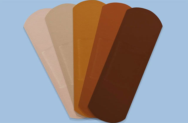 Band Aid. Five bandage strips ranging in color from light tan to dark brown.
