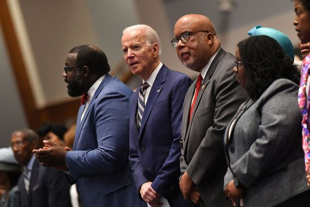 Four people standing in church, three African Americans and one Caucasian man in suit, Democratic presidential candidate Joe Biden