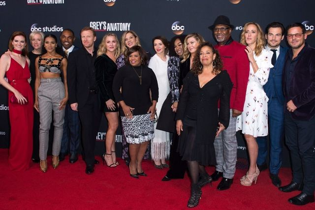 "The cast of the ABC show, ""Grey's Anatomy"" on a red carpet including Black woman creator and writer, Shonda Rhimes."