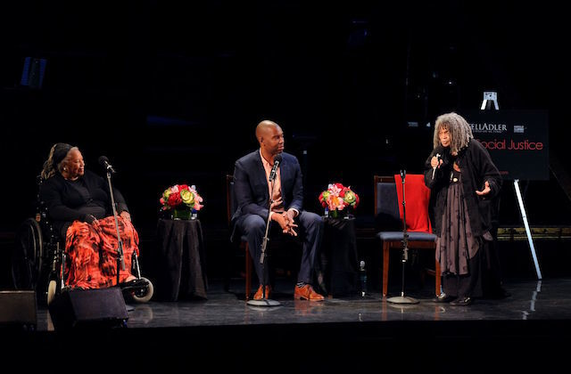 (L to R) Toni Morrison, Ta-Nehisi Coates and Sonia Sanchez on dimly lit stage