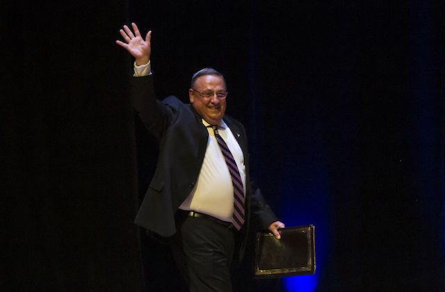 Paul LePage in navy suit with pink and navy striped tie