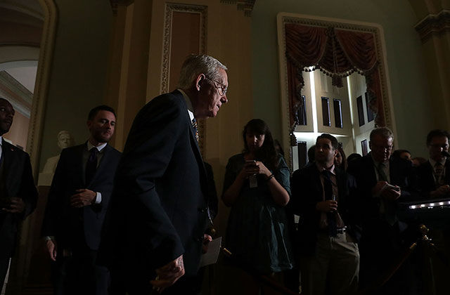 U.S. Senate Minority Leader Sen. Harry Reid (D-Nev.) arrives at a news briefing at the Capitol September 27, 2016, in Washington, DC. A day later, he'll defend necessary action from the Congress for the #FlintWaterCrisis.