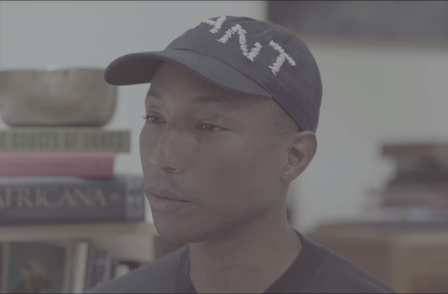 Pharrell Williams looks off camera