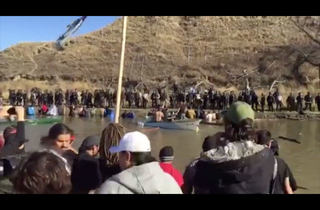 Police and Dakota Access Pipeline opponents stand off on November 2, 2016, along the Cannonball River.