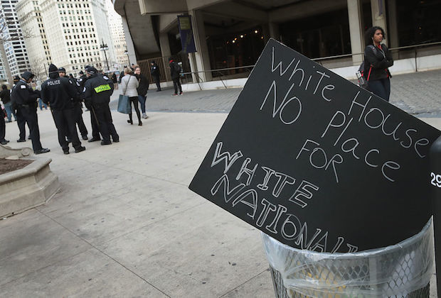 Sign in trash reads: White House no place for White nationalism""