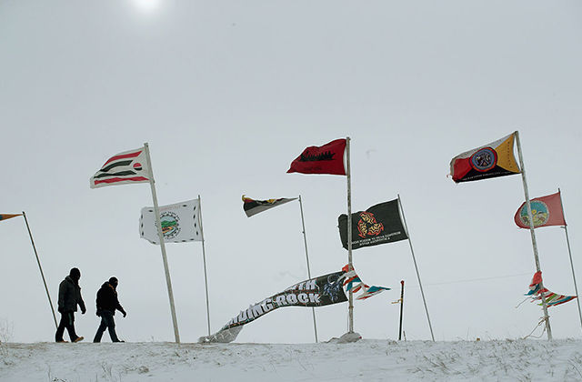 These flags from different tribal nations once dotted Flag Road in the Oceti Sakowin Camp. Now, authorities have cleared out the camp and are on track to begin cleanup.