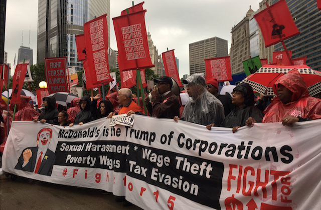 "Protestors hold sign that reads: ""McDonald's is the Trump of Corporations"""