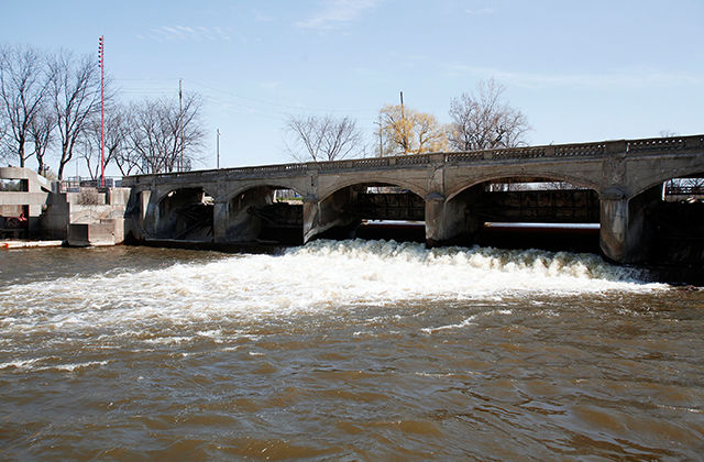 The Flint River is shown in downtown Flint April 20, 2016, in Flint, Michigan. The switch to Flint River from the Great Lakes Water Authority ultimately led to the water crisis. Now, officials want the city to stay with the water authority.