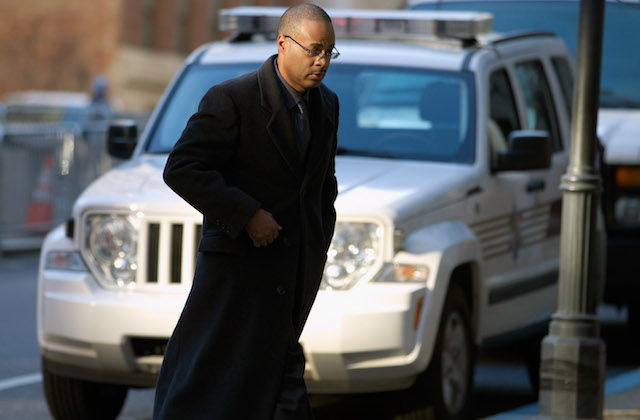 Caesar Goodson Jr. in navy trenchcoat, walking to courthouse.