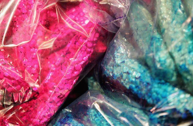 Blue and pink pills in plastic bags
