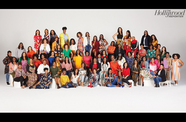Lena Waithe and Black Women Who Brunch. Group of Black women in multicolored clothing sit and stand on or near white blocks on white floor in front of white wall