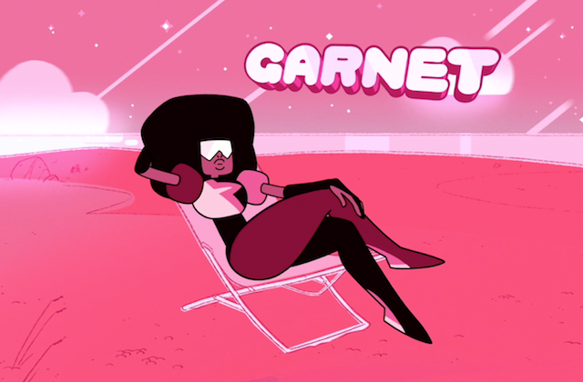 Garnet. Ruby-hued alien reclines in a beach chair, legs crossed.