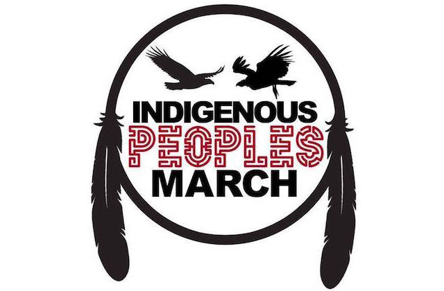 "Black and red text spells ""INDIGENOUS PEOPLES MARCH"" underneath two black silhouettes of birds within black circle with black feathers on white background"