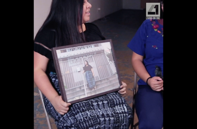 A Maya teen holds a portrait of herself wearing a traditional corte dress