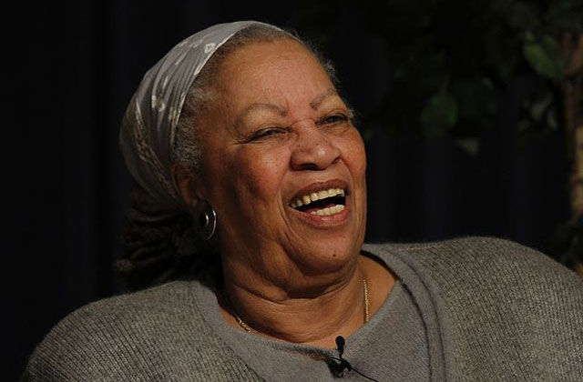 Toni Morrison. Elder Black woman wearing gray sweater and gray silk scarf on head.