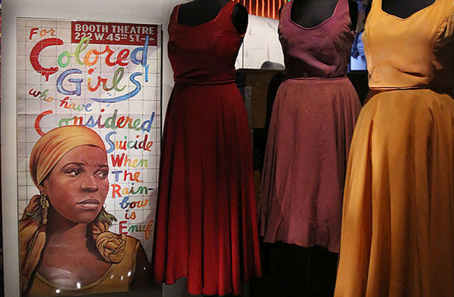 For Colored Girls. Book cover and red, yellow and brown dresses.