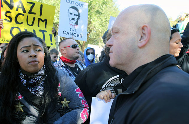 White Lives Matter rally. Black woman stares down White man.