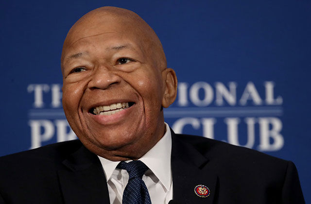 Elijah Cummings. Older Black man with bald head waring dark suit jacket, dark tie and white shirt.