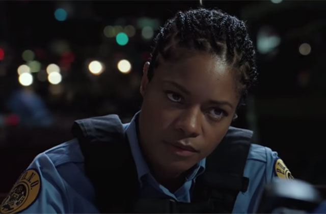 Naomie Harris. Black woman with braids wearing police uniform.