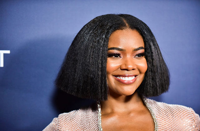 Gabrielle Union. Black woman with chin-length bob wearing sparkly top.