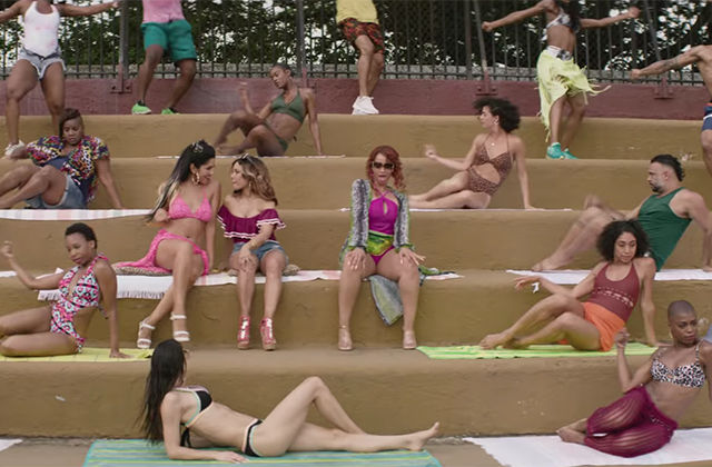 In the Heights. A scene showing women of color at a pool on steps.